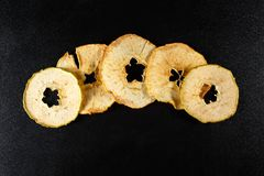 Dried apple slices on black background Stock Images