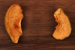 The Dried Apple Fruit on the wood Stock Photography