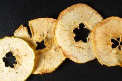 Dried apple slices on black background Stock Photos