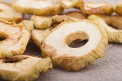 Dried apple slices on textile background Royalty Free Stock Images
