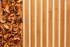 Dried apples on a bamboo mat Royalty Free Stock Photo
