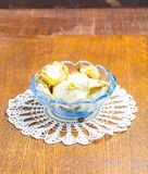 Dried apples in glass bowl on wooden table Stock Photography