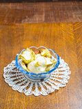 Dried apples in glass bowl on wooden table Royalty Free Stock Image