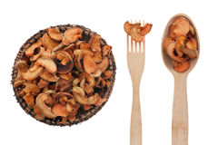 Dried apples in a plate, fork and spoon Stock Photography