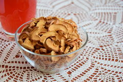 Dried apples. Slices in a plate on a vintage tablecloth Stock Photography