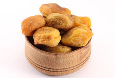 Dried apricot with a bone in the form of round wood Royalty Free Stock Photo