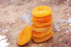 Dried apricot. Many dried apricot on wooden background royalty free stock photos