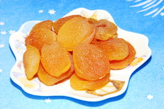 Dried apricots. Dry fruit on a blue background Stock Photography