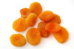 Dried apricots. Some dried apricots on the white background Stock Photo