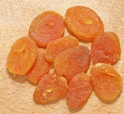 Dried apricots. Image of dried apricots isolated on wooden background Stock Photos