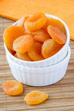 Dried apricots. In a white ceramic bowl Royalty Free Stock Photography