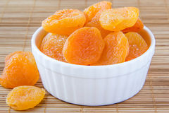 Dried apricots. In a white ceramic bowl Stock Photo