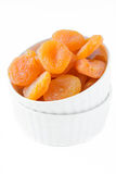 Dried apricots. In a white ceramic bowl Royalty Free Stock Images