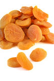 Dried apricots. Pile of dried apricot fruits isolated on white Royalty Free Stock Images