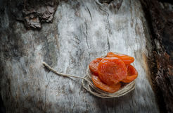 Dried apricots on aged wood with twine Royalty Free Stock Photo