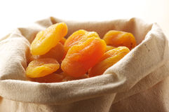 Dried apricots in bag Stock Photography
