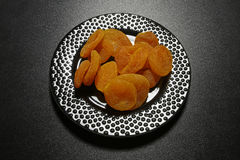 Dried apricots on black background Royalty Free Stock Photos