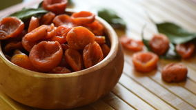 Dried apricots in a bowl stock footage