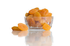 Dried apricots in a bowl isolated on white Royalty Free Stock Image