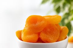 Dried apricots in a bowl royalty free stock photography
