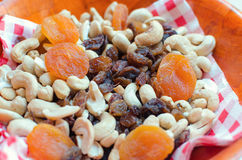 Dried apricots, cashew, dry raisins and peanuts. In a bowl Royalty Free Stock Photos