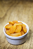 Dried apricots in a ceramic white bowl Royalty Free Stock Image