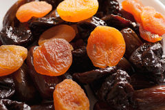 Dried apricots with dates and prunes closeup Stock Photos