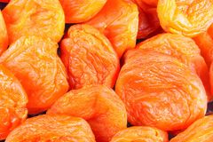 Dried apricots - dried halves of apricot fruit without seeds. Dried apricots are popular in cooking, sweet dried fruit, healthy stock photo