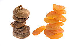 Dried apricots and figs. Isolated on white background Stock Photography