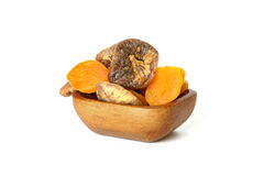 Dried apricots and figs in bowl on white. Dried tasty apricots and figs in bowl on white background Royalty Free Stock Images