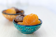 Dried apricots and figs on a plate Royalty Free Stock Photos