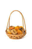 Dried apricots and figs in a wicker basket isolated on white Royalty Free Stock Photo