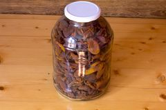 Dried apricots in a glass jar on a wooden table. Ecologically clean food. Healthy fruit apricots. Dried apricots in a glass jar on a wooden table. Ecologically stock photo