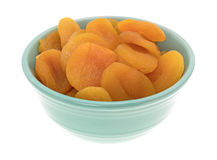 Dried apricots in a green bowl Royalty Free Stock Images