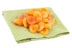 Dried Apricots on a green napkin isolated on white Royalty Free Stock Photography