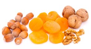 Dried apricots, hazelnut, open walnut Royalty Free Stock Images