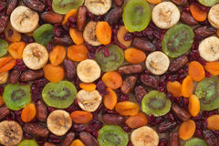 Dried apricots, kiwi, figs, dates, cranberries on sackcloth Royalty Free Stock Photography