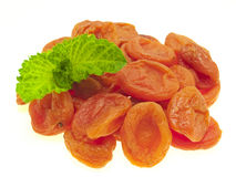 Dried apricots and mint. Stock Photos