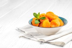 Dried apricots with mint in a bowl. The concept is healthy food, Royalty Free Stock Photos