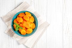 Dried apricots with mint in a bowl. Copy Space. The concept is h Royalty Free Stock Image