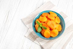 Dried apricots with mint in a bowl. Top view. The concept is hea Royalty Free Stock Photography