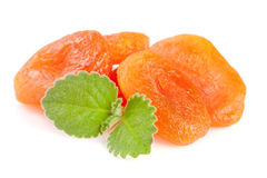 Dried apricots with mint leaves isolated on white background Royalty Free Stock Images