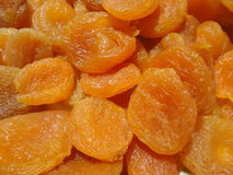 Dried apricots orange background Royalty Free Stock Image