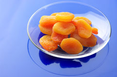 Dried apricots on plate Royalty Free Stock Photo