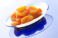 Dried apricots on plate Stock Image