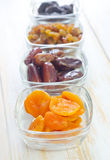 Dried apricots, raisins and dates Stock Photos