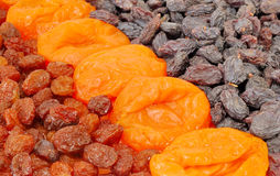 Dried apricots and raisins are two types of Royalty Free Stock Photos