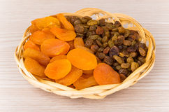 Dried apricots and raisins in wicker basket Royalty Free Stock Photography