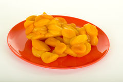 Dried Apricots On Red Plate Royalty Free Stock Photos