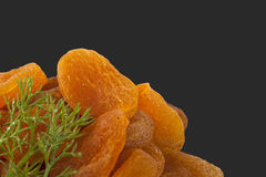 Dried apricots and rosemary Stock Image